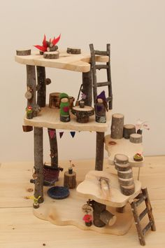 This Tree House is made with clean, dry branches and smoothly sanded pine boards. The open concept home allows multiple children to join the fun Wooden Tree House, Toy Trees, Fairy Tree Houses, Open Concept Home, Small World Play, Kids Wood, Doll Crafts, Wood Toys, Diy Toys