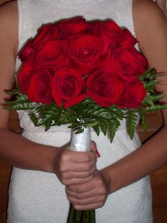 Wildrose Floral Design Wedding Gallery. The classic all Red Rose Bouquet. You may here this called 'The Martha' (yes, as in Martha Stewart). There are so many variations of this bouquet using mixed rose colors, simple accent flowers, ribbon and collar choices. Contact at wildrosefloraldesign.net or check it out on Facebook.