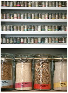 this is a sand collection, but a wall of spices in uniform jars would look great too