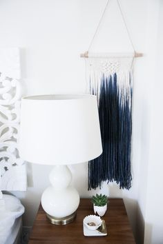 bedroom before and after, bedroom makeover, boho bedroom, bohemian bedroom, light and bright home decor, apartment decor, urban outfitters headboard, anthropologie bedding, macrame wall hanging, white bedroom, west elm side table, target lamp