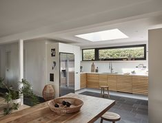 This VELUX roof window in a single storey extension looks like it doubles (at least) the daylight into the kitchen Hidden Door Bookcase, Hidden Doors, Single Storey Extension, Bar Shed, Backyard Bar, Roof Window, White Backdrop, Basement Renovations, White Space