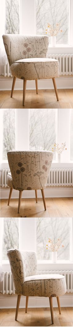A cocktail chair in Paper Meadow fabric by Hebden Bridge designer/maker Hannah Nunn. The fabric is printed on a neutral cotton/linen mix and has brown and dusky pink meadow grasses, dandelion clocks and cow parsley. The fabric is suitable for curtains and light upholstery. We can make you a chair like this in any of the Hannah Nunn fabrics on the website www.hannahnunn.co.uk