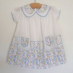 asian blue c. 1940  fine cotton smock dress with big peter pan collar + baby blue trim.  all hand finished with the lovely contrasting fabric of leaves + asian characters.