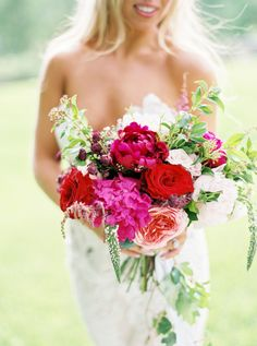 Bold peony, ranunculus, rose, and astilbe wedding bouquet: Photography: Photographs By Caileigh - www.photosbycaileigh.com   Read More on SMP: http://www.stylemepretty.com/2016/11/16//