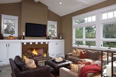 Very cozy living room, love the peak ceilings, tile fireplace and big comfy couches
