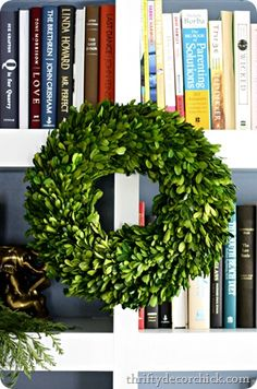 "Christmas Bookshelf Decor  {Thrifty Decor Chick} book""s and Christmas, a winning combination!"