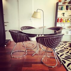 """Amazing dining-room set made of 4 chrome armchairs covered with a nice brown leather combined with a matching dining-table. All designed in the 60s for the Pan American World Airways also called Pan Am. On the chairs, the structure of steel wire reminds the shape of the """"Pan Am"""" logo. This style makes optical illusions just like """"Op art"""", then in vogue in the 1960s. Very pretty!"""