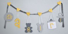 Yellow and grey baby shower decorations. This is cute and can be made for anything.