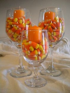 Candle in Candy corn vase. Easy holiday decor.