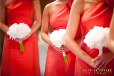White bouquets for and orange coral red bridesmaid dresses.