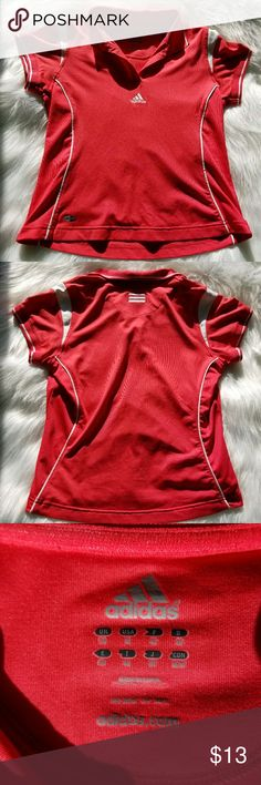 Women's Adidas Short-sleeved Climalite Polo Shirt This Women's Short-sleeved Climalite Polo Shirt by Adidas is a size medium. It is bright red in color and features a collar, a white adidas logo on the front and 3 white lines in the upper back as well as the Climalite logo on the front bottom left.  It is in great condition but the tag with the washing instructions has been cut out.  Like new! Adidas Tops