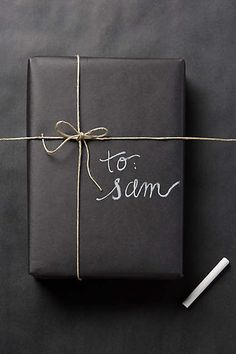 I love wrapping gifts. Guess I better start prepping for Christmas! Chalkboard Gift Wrap - anthropologie.com