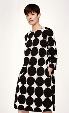 The off white and black Pienet Kivet pattern adorns the Unelma dress made of cotton poplin with a lining, cropped sleeves, a boat neckline and an A-line cut to the above-knee hemline. The dress has a concealed zipper at the back seam and pockets at the si Marimekko Dress, Ankara Gown Styles, Quoi Porter, Black And White Love, Fashion Project, Online Dress Shopping, Clothes For Sale, Work Clothes, Gowns