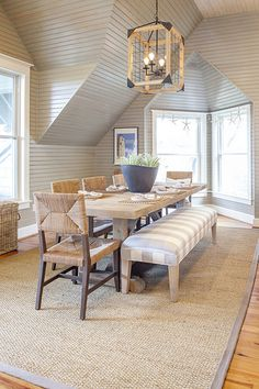 nice natural materials and textures, beadboard, light, charis and bench and table
