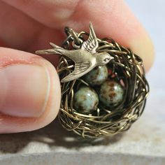 An Easy Jewelry Design done with Interwrapped Metal Wire, 3 Beads and a Bird Charm. Great Idea.
