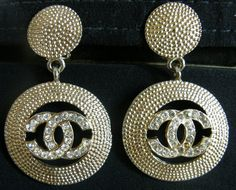 Vintage 1980s Chanel Gold Tone with CC Logo in Crystal and Signed Dangle Earrings. $489.00, via Etsy.