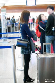 Krystal airport fashion 150325. Cr: Soojung-a