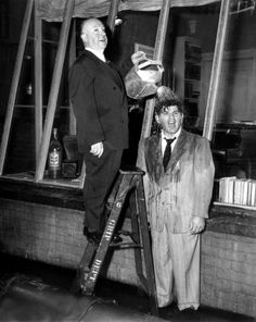 Alfred Hitchcock and Raymond Burr joke around on the set of Rear Window.