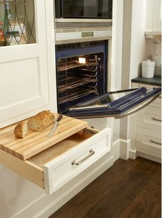 Kitchen cabinet drawer with cutting board insert.  (Takes no alterations to just place a cutting board across an open drawer for extended counter space when needed - I do it all the time.)