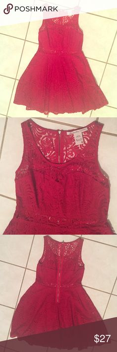 American Rag Red Lace Dress Beautiful lace dress by American Rag. Perfect shade of red. The lace is see through on the back and top of chest and there is a see through lace strip separating the top and bottom of the dress. The bustier part is lined as well as the bottom. Zips in back. Size medium. I only wore this once to a party last year so it's in perfect condition. American Rag Dresses