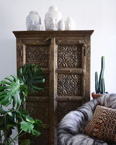 chinese marble buddha head collection indian brass cabinet, african kuba cloth pillow, cactus, #monstera /apartmentf15/