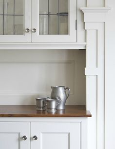 Like the lead glass on the cabinet doors and the wood on the base for a more farm country look to break up the hard surfaces of the counters.