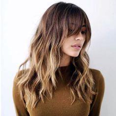 kaküllü dalgalı uzun saç kesimi