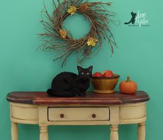 "Dollhouse Miniature 1:12 ""Crouching Black Cat"" is a freehand sculpture of polymer clay & silk fibers."