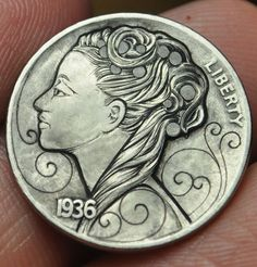 Carved Nickel. Now this is a cool take on the old nickel. I like it!