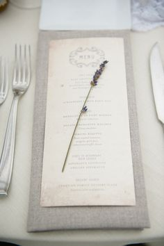 Simple linen napkin, with a cream menu, topped with one lavender bloom. I am so glad to see more natural wedding themes such as this reappearing on the wedding scene, for a minute there it all went a bit snow queen white!
