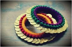 Rs.650 for a pair  ***We also accept bulk orders***  This bangle is full of colorful velvet balls and traditional coins