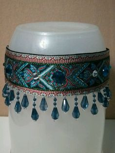 Blue martingale with beaded dangles.