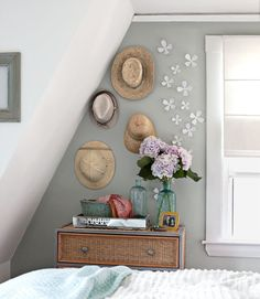Sneaky storage: hang your hats on the wall for storage as well as art.     #storage #bedrooms