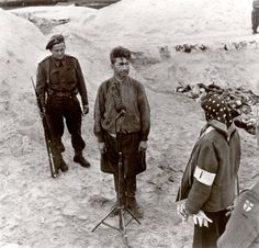 Bergen Belsen, Germany, Fritz Klein facing a survivor next to a mass grave, after the liberation of the camp, April 1945.