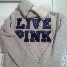 """Victoria's Secret fur-lined sweatshirt Victoria's Secret grey zip up sweatshirt. Super warm with fit lining and a lip down good! """"LIVE PINK"""" on the back in royal blue velvet letters. 2 tiny faded yellow spots, one on the front and one on the sleeve. Not noticeble! Great condition otherwise! Victoria's Secret Sweaters"""