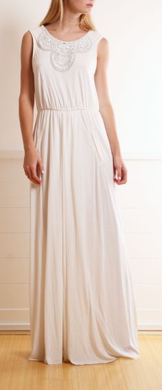 embellished white dress with leather piping around the arm holes
