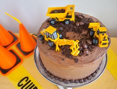Easy Construction Birthday Cake - Merriment Design Easy construction birthday cake for a construction birthday party. Make this bakery-grade cake and icing recipe - it tastes amazing! Digger Birthday Cake, Digger Cake, Truck Birthday Cakes, Paw Patrol Birthday Cake, Birthday Cake Girls, 2nd Birthday, Birthday Stuff, Tonka Truck Cake, Truck Cakes