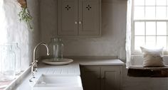 Shaker Lagoon Silestone Double Sink mushroom cabinets white walls dark floors