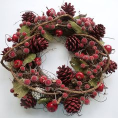 red berry and pine cone wreath by country heart | notonthehighstreet.com