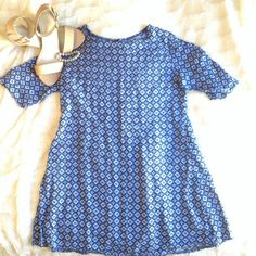 Cute Blue Floral Patterned Dress The pattern on this dress is beautiful and fun! The material is thin and allows your body to breathe. Also have this is a purple if you are interested. Dresses Mini