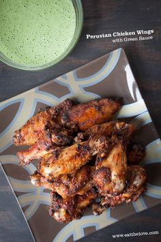 Peruvian Chicken Wings with Peruvian Green Sauce. Photo and recipe by Irvin Lin of Eat the Love. Omit the sour cream to make the sauce paleo. Peruvian Dishes, Peruvian Cuisine, Peruvian Recipes, Cooking Chicken Wings, Chicken Wing Recipes, Peruvian Chicken, Tapas, Cooking Recipes, Healthy Recipes