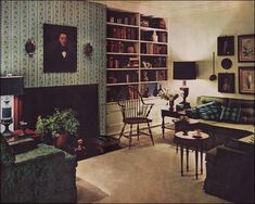 This green, peacock blue, and straw-colored living room is Colonial but much more saturated in hue than was seen during the 1950s. Modern updates include the simplified profile of the chairs and sofa and lighting along with a more contemporary interpretation of pattern in the wallpaper and upholstery.