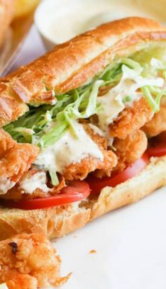 Shrimp po' boy sandwich- Crispy Crunchy shrimp piled mile high on buttered toasted French roll, stuffed with crunchy cabbage, Fresh tomatoes - drizzled with a lip smacking remoulade sauce . Cajun Recipes, Fish Recipes, Seafood Recipes, Great Recipes, Dinner Recipes, Cooking Recipes, Healthy Recipes, Recipies, Creole Recipes