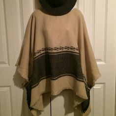 Oversized Pullver Frayed Blanket Poncho Lightweight and soft, perfect for summer nights! Creme with gray design and frayed edging. Has place at style sewn sleeves. This is very casual and fun to wear. Sweaters Shrugs & Ponchos