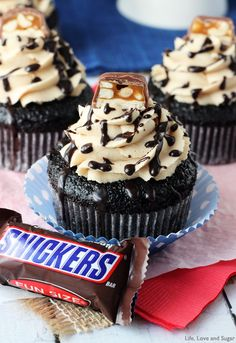 "Snickers Cupcakes <a class=""pintag"" href=""/explore/Recipe/"" title=""#Recipe explore Pinterest"">#Recipe</a>! Chocolate cupcake filled with caramel, marshmallow fluff and peanuts! Topped with peanut butter icing!"