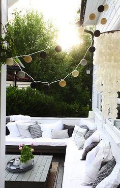 Patio Sofa with White Cushions and String Lights I Gardenista