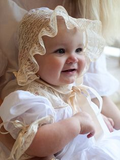 Beautiful Juliana is wearing her christening gown made and design by Mela Wilson .