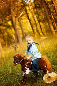 I've done a shoot like this! The little guy had his daddy's cowboy boots on and oh my goodness, words do not express how adorable they turned out!