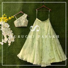 Mint Green Floral Lehenga With Off-Shoulder Lehenga Blouse by Suruchi Parakh. Latest Suruchi Parakh Lehengas include bridesmaid outfits, brides prewedding outfits, and some gorgeous brides family outfits all under INR Indian Bridal Outfits, Indian Designer Outfits, Indian Designers, Designer Dresses, Lehnga Dress, Lehenga Blouse, Lehenga Designs, Saree Blouse Designs, Saris