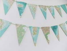Garland of Map bunting - upcycled garland made from a vintage world atlas - eco friendly wedding decor - recycled banner - What a great idea! Map bunting upcycled garland made from vintage maps by peonyandthistle on etsy - Bunting Garland, Buntings, Baby Nursery Diy, Nursery Decor, Nursery Ideas, Garland Wedding, Wedding Decorations, Travel Decorations, Decor Wedding